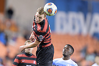 Houston, TX - Friday December 9, 2016: Tanner Beason (3) of the Stanford Cardinal heads the ball away from his goal against the North Carolina Tar Heels at the NCAA Men's Soccer Semifinals at BBVA Compass Stadium in Houston Texas.
