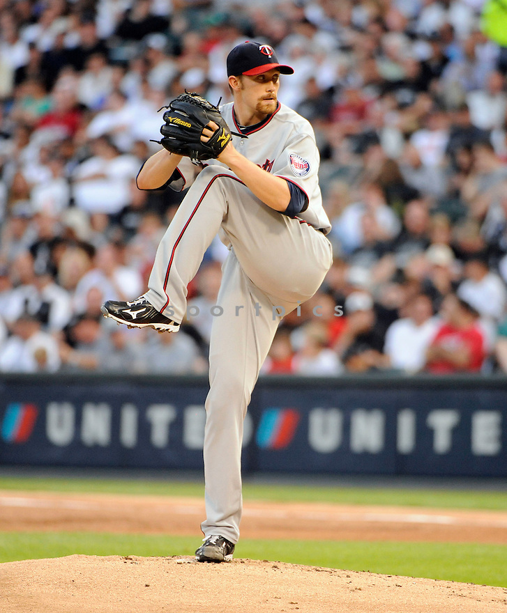SCOTT BAKER, of the Minnesota Twins, in action during the Twins  game against the Chicago White Sox  at US Cellular Field in Chicago, IL on August 10, 2010.  The Twins won the game 12-6...