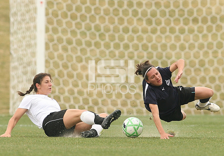 Lisa De Vanna (blue) of the Washington Freedom is tripped by Yael Averbuch  of Sky Blue F.C. during a WPS pre season match at Maryland Soccerplex, in Boyd's, Maryland on March 14 2009. Sky Blue won the match 1-0