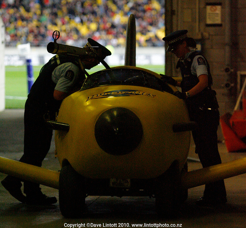 Police check Captain Hurricane's plane, possibly for a WOF, during the Super 14 rugby match between the Hurricanes and Crusaders at Westpac Stadium, Wellington, New Zealand on Friday, 2 April 2010. Photo: Dave Lintott / lintottphoto.co.nz