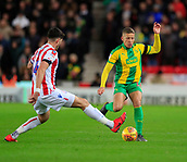 9th February 2019, bet365 Stadium, Stoke-on-Trent, England; EFL Championship football, Stoke City versus West Bromwich Albion; Dwight Gayle of West Bromwich Albion is challenged by Danny Batth of Stoke City