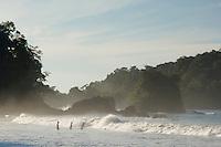Beach with islands and tourist, Manuel Antonio , Central Pacific Coast, Costa Rica, Central America, December 2006