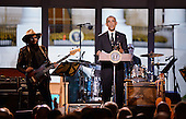 "United States President Barack Obama makes remarks during ""A Salute to the Troops: In Performance at the White House"" on the South Lawn of the White House, November 6, 2014 in Washington, DC.  The President and first lady invited music legends, members of the U.S. military, military veterans, and their families to the White House for a celebration of the men and women who serve in the U.S. Armed Forces.<br /> Credit: Olivier Douliery / Pool via CNP"