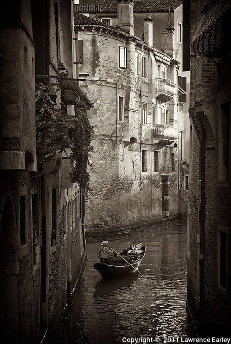 "Classic scene of a gondola, gondoliere and late afternoon light down a canal near San Marco. Funny scene one day: a gondoliere chastising a group of grim looking tourists in his gondola. ""You come to Venice to be happy!"" he shouted. ""Smile, laugh, have a good time!"""