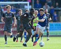 Lincoln City's John Akinde vies for possession with Carlisle United's Tom Parkes<br /> <br /> Photographer Chris Vaughan/CameraSport<br /> <br /> The EFL Sky Bet League Two - Carlisle United v Lincoln City - Friday 19th April 2019 - Brunton Park - Carlisle<br /> <br /> World Copyright © 2019 CameraSport. All rights reserved. 43 Linden Ave. Countesthorpe. Leicester. England. LE8 5PG - Tel: +44 (0) 116 277 4147 - admin@camerasport.com - www.camerasport.com