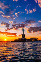 Statue of Liberty at sunset, New York Harbor, New York, New York USA.