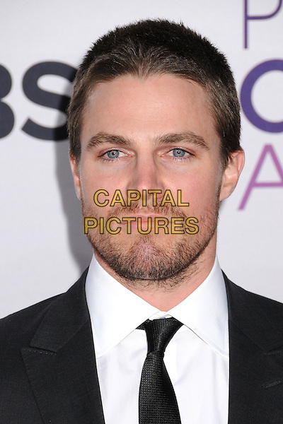 Stephen Amell.People's Choice Awards 2013 - Arrivals held at Nokia Theatre L.A. Live, Los Angeles, California, USA..January 9th, 2013.headshot portrait black suit white shirt stubble facial hair .CAP/ADM/BP.©Byron Purvis/AdMedia/Capital Pictures.
