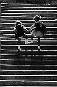 Children skipping up stairs on way to school, 1969
