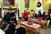 First lady Laura Bush meets with a group of teachers from Afghanistan in theYellow Oval Room of the White House in Washington, DC on December 10, 2003.  The teachers are in the United States on an educational exchange sponsored by the United States Department of State's Bureau of Educational and Cultural Affairs and the United States Afghan Women's Council.<br /> Mandatory Credit: Susan Sterner / White House via CNP