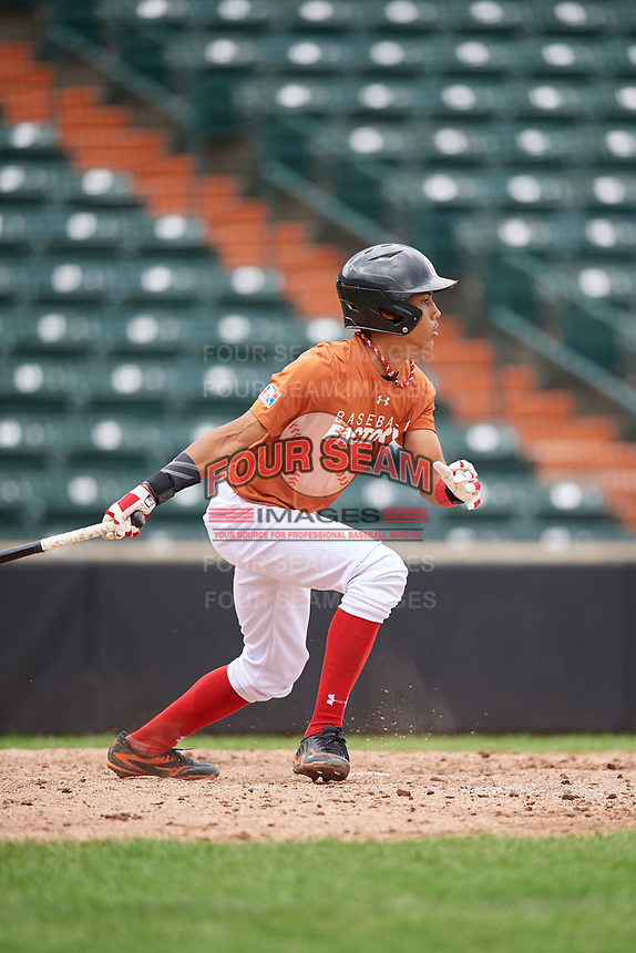 Brenny Escanio (5) follows through on a swing during the Dominican Prospect League Elite Underclass International Series, powered by Baseball Factory, on July 21, 2018 at Schaumburg Boomers Stadium in Schaumburg, Illinois.  (Mike Janes/Four Seam Images)