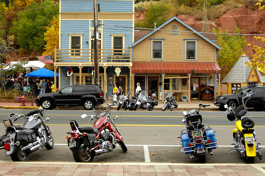 Motorcycles line the street in downtown Manitou Springs, CO. Michael Brands for The New York Times.