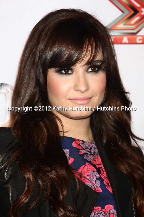 LOS ANGELES - DEC 6:  Demi Lovato arrives to the X Factor 2012 Final Four Party at Rodeo Drive on December 6, 2012 in Beverly Hills, CA