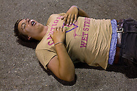 BENICÀSSIM, SPAIN - A festival goer lies passed out on the tarmac of the festival site outside the dance tent. ..Described by some as a Mediterranean Glastonbury, the Festival Internacional de Benicàssim (FIB) is the largest music festival outside the UK to target British visitors. In 2010, seven of the eight main headline slots were filled by English bands...A small coastal town of 13,000 inhabitants, Benicàssim hosted some 200,000 visitors in 2009, with 40% of those believed to be coming from the UK. In 2010, attendances fell to 127,000 visitors but the percentage of UK visitors is believed to have risen.
