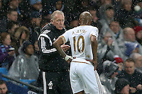 Swansea City Caretaker Manager Alan Curtis issues instructions as he stands in the technical area Andre Ayew during the Barclays Premier League Match between Manchester City and Swansea City played at the Etihad Stadium, Manchester on 12th December 2015