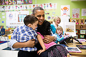 United States President Barack Obama hugs students during a visit to a pre-kindergarten classroom at the College Heights Early Childhood Learning Center in Decatur, Georgia, February 14, 2013. .Mandatory Credit: Pete Souza - White House via CNP