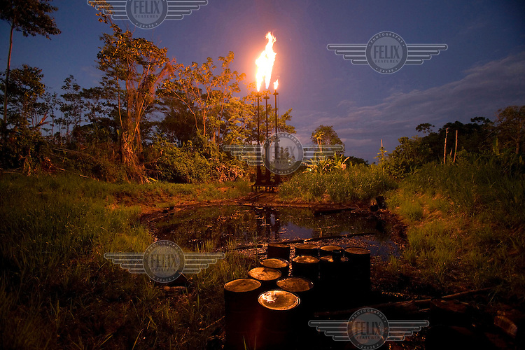 A tower burning off natural gas above a pool of crude oil and waste left by Petro Ecuador, a company that took over from Texaco. A class action lawsuit was brought against US multinational oil giant Texaco (acquired by Chevron in 2001) by more than 30,000 Ecuadorians. The case has been in the Ecuadorian courts since 2003 and relates to the dumping of billions of gallons of toxic materials into unlined pits and Amazonian rivers. In February 2011 the court ruled that Chevron should pay a fine totalling 9.5 billion USD. However, Chevron has stated that the ruling is 'illegitimate and unenforceable' and has started numerous counter proceedings in US courts. There is some doubt as to whether it will be possible to force Texaco to pay the fine.