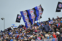 A Bath Rugby supporter in the crowd waves a giant flag. Aviva Premiership match, between Bath Rugby and Wasps on February 20, 2016 at the Recreation Ground in Bath, England. Photo by: Patrick Khachfe / Onside Images