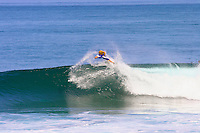 World Champion bodyboarder, Jeff Hubbard from Kauai does an air roll spin at Off the Wall on Oahu's North Shore. Jeff Hubbard has also graduated Hawaii Pacific University with both bachelors and masters degrees.