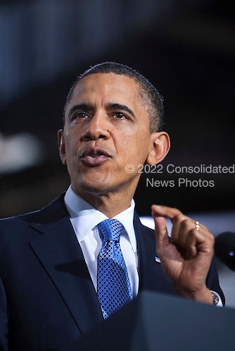 United States President Barack Obama delivers remarks to the employees of a UPS shipping facility after viewing vehicles from AT&T, PepsiCo, UPS and Verizon's clean fleets, at the same location in Landover, Maryland, USA, on April 01 2011..Credit: Jim LoScalzo / Pool via CNP