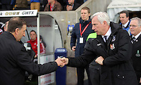 (L-R) Swansea chairman Huw Jenkins greeted by Crystal Palace manager Alan Pardew before the Barclays Premier League match between Swansea City and Crystal Palace at the Liberty Stadium, Swansea on February 06 2016
