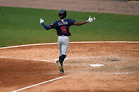 Right fielder Justin Ellison (5) of the Rome Braves spreads his arms as he scores on a home run in game one of a doubleheader against the Greenville Drive on Tuesday, May 30, 2017, at Fluor Field at the West End in Greenville, South Carolina. Rome won, 10-7. (Tom Priddy/Four Seam Images)