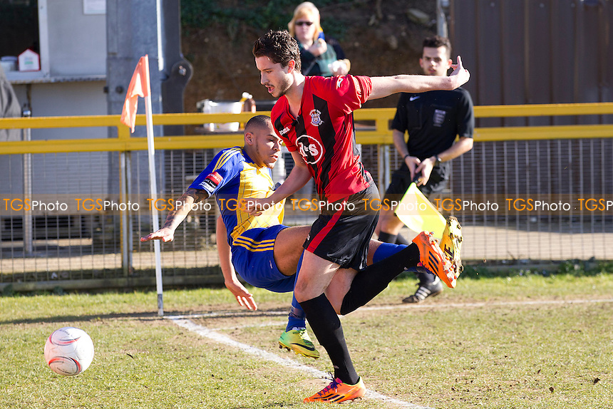 Callum Ibe of Romford gets in a bit of a tangle as the Chatham defender prevents his cross - Romford vs Chatham Town - Ryman League Division One North Football at the Thurrock FC, Ship Lane - 07/03/15 - MANDATORY CREDIT: Ray Lawrence/TGSPHOTO - Self billing applies where appropriate - contact@tgsphoto.co.uk - NO UNPAID USE