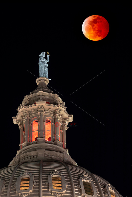 A Super blood wolf moon glows over the Texas State Capitol dome during a lunar eclipse in Austin, Texas.<br />