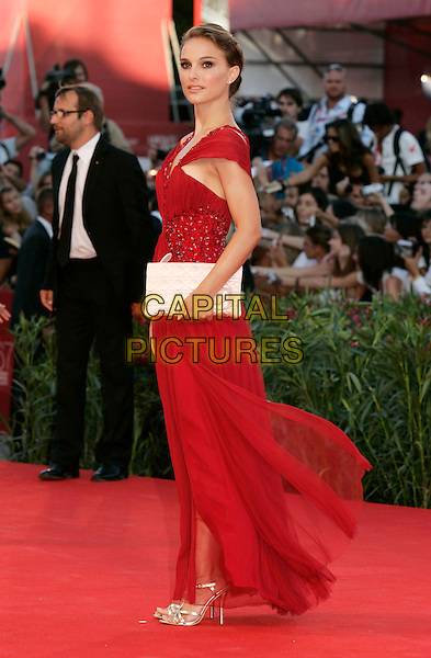 "NATALIE PORTMAN.""Black Swan"" premiere & opening night of the 67th Venice International Film Festival, Venice, Italy..September 1, 2010.full length red dress maxi off the shoulder clutch bag white embellished jewel encrusted side .CAP/PE.©Peter Eden/Capital Pictures."