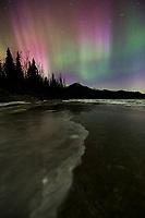 Colorful magenta and green aurora borealis lights the nights sky in Alaska's Brooks Range, arctic, Alaska