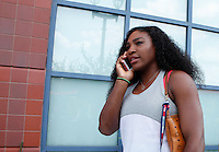 Serena Williams Speaks on the phone during the 2015 U.S. Open tournament kids day in New York City 08/29/2015. Kena Betancur/VIEWpress