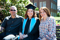 Elementary Education Spring graduate with family on bench <br />  (photo by Sarah Dutton / &copy; Mississippi State University)