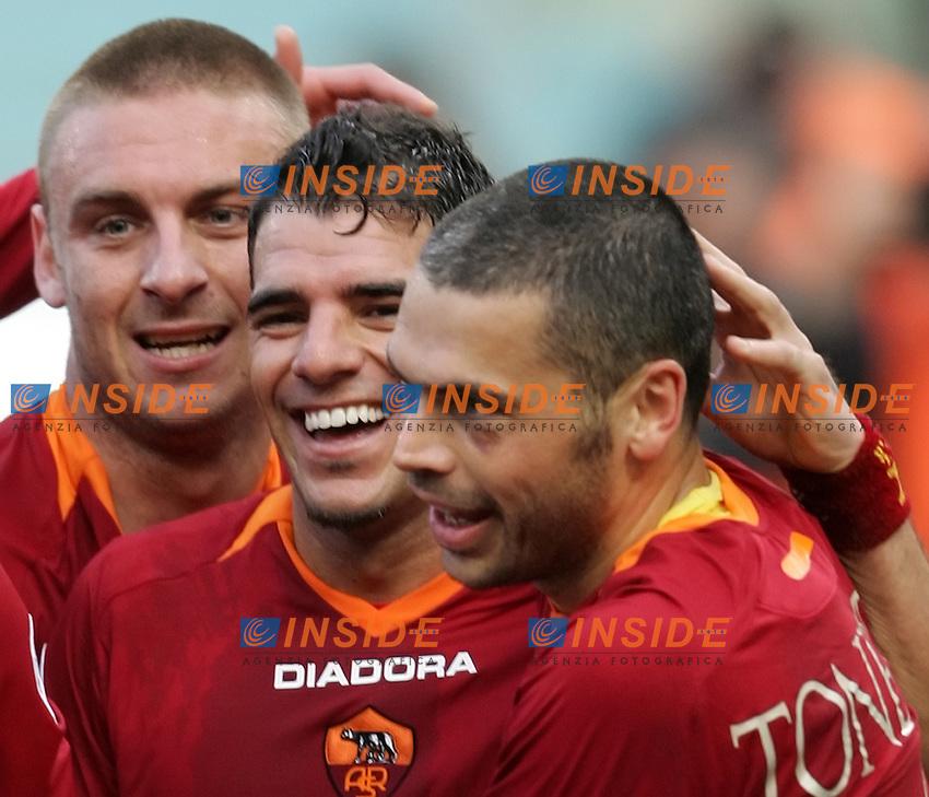 As Roma team group<br /> Italian &quot;Serie A&quot; 2006-07<br /> 11 Feb 2007 (Match Day 23)<br /> Roma-Parma (3-0)<br /> &quot;Olimpico&quot;-Stadium-Roma-Italy<br /> As Roma Midfielder Simone Perrotta (C) celebrates after scoring with teammates Max Tonetto (L) and  Daniele De Rossi <br /> Esultanza di Simone Perrotta dopo il gol<br /> Photographer: Andrea Staccioli INSIDE