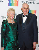 J.W. Marriott, Jr. and his wife, Donna Garff, arrive for the formal Artist's Dinner honoring the recipients of the 2013 Kennedy Center Honors hosted by United States Secretary of State John F. Kerry at the U.S. Department of State in Washington, D.C. on Saturday, December 7, 2013. The 2013 honorees are: opera singer Martina Arroyo; pianist,  keyboardist, bandleader and composer Herbie Hancock; pianist, singer and songwriter Billy Joel; actress Shirley MacLaine; and musician and songwriter Carlos Santana.<br /> Credit: Ron Sachs / CNP