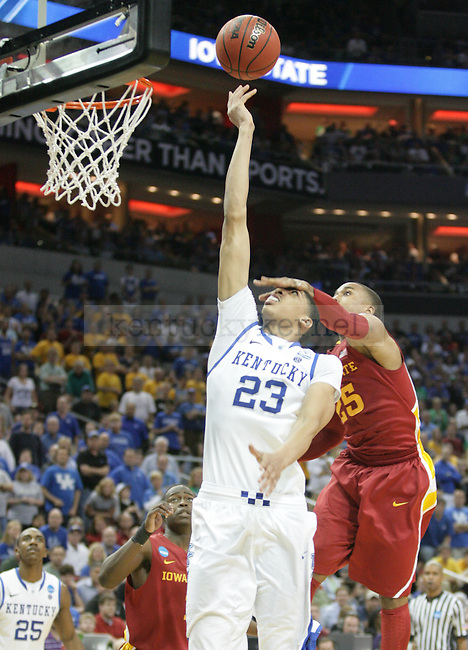 Freshman forward Anthony Davis shoots a layup against pressure from Iowa State's Tyrus McGee during the second half of the UK vs. Iowa State NCAA third round game at the KFC Yum! Center March 17, 2012. Photo by Brandon Goodwin | Staff