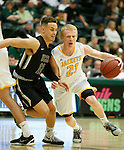 SPEARFISH, SD - FEBRUARY 4, 2017 -- Connor O'Hearn 21 of Black Hills State drives into UCCS defender Elijah Ross #12 during their Rocky Mountain Athletic Conference game Saturday at the Donald E. Young Center in Spearfish, S.D.  (Photo by Dick Carlson/Inertia)