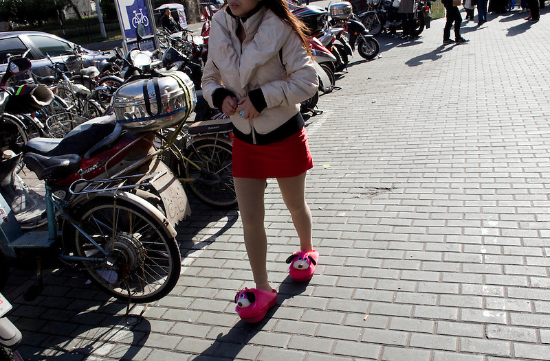 A woman walks in her slippers in Shanghai.