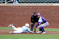 CHAPEL HILL, NC - FEBRUARY 19: Dylan Harris #3 of the University of North Carolina beats a pickoff tag attempt by Evan Bergman #10 during a game between High Point and North Carolina at Boshamer Stadium on February 19, 2020 in Chapel Hill, North Carolina.