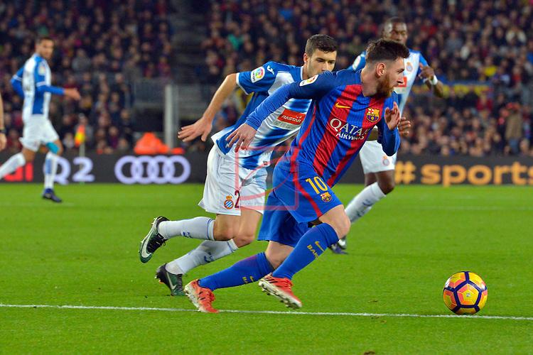 League Santander 2016/2017. Game: 16.<br /> FC Barcelona vs RCD Espanyol: 4-1.<br /> Lionel Messi vs Aaron Martin.