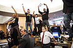 SACRAMENTO, CALIFORNIA - MARCH 27, 2018: Protestors take over the front desk and lobby of City Hall during a city council meeting.