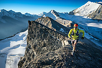 Arriving to the summit of the Barrhorn, 3610 meters, the highest trail in Europe, during the Via Valais, a multi-day trail running tour connecting Verbier with Zermatt, Switzerland.
