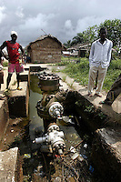 In the midlle of the fishing village of Okoritak is a disused oil well. Recently, after ten years of neglect, the well was fitted with new parts. The villagers fear they will be forced to move without compensation. They are also angry because the waters are polluted from a nearby Mobile-Exxon oil facility. Unlike their neighbours across the river the village has not recived any benifits from the oil company. © Fredrik Naumann