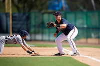 Atlanta Braves first baseman Austin Bush (59) waits for a pickoff attempt throw as Danny Woodrow (22) dives back to the bag during an Instructional League game against the Detroit Tigers on October 10, 2017 at the ESPN Wide World of Sports Complex in Orlando, Florida.  (Mike Janes/Four Seam Images)