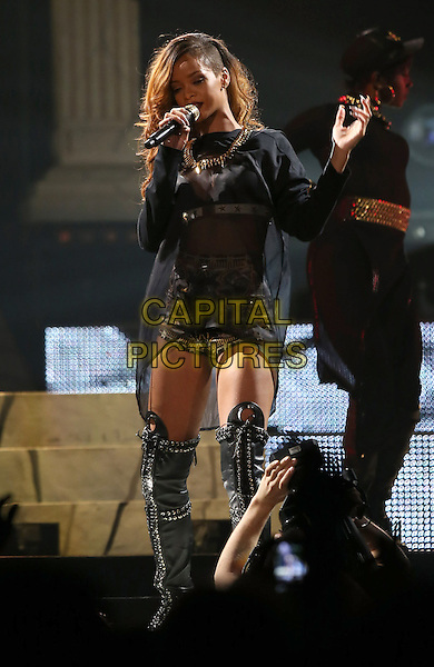 Rihanna  (Rihanna Robin Fenty).Rihanna performs at the Mandalay Bay Event Center, Las Vegas, NV, USA, 12th April 2013..music performing live on stage concert gig full length black knee high thigh otk over the leather boots sheer see through thru top lace dress bra shorts hotpants jacket kimono gold necklace studded lace-up singing microphone hand .CAP/ADM/MJT.© MJT/AdMedia/Capital Pictures