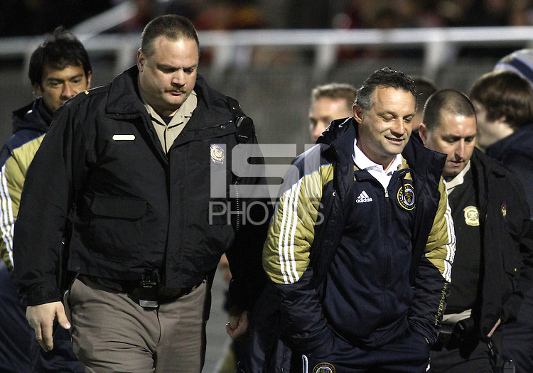 Peter Nowak coach of the Philadelphia Union leaves the field after receiving a red card during a play-in game for the US Open Cup tournament against D.C. United at Maryland Sportsplex, in Boyds, Maryland on April 6 2011. D.C. United won 3-2 after overtime penalty kicks.
