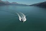 Kenai Fjords Tours boat in Resurrection Bay departing Seward, Alaska.