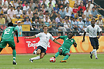 13 August 2008: Stuart Holden (USA) (7 white) and Chinedu Ogbuke (NGA) (7 green) challenge for the ball.  The men's Olympic team of Nigeria defeated the men's Olympic soccer team of the United States 2-1 at Beijing Workers' Stadium in Beijing, China in a Group B round-robin match in the Men's Olympic Football competition.
