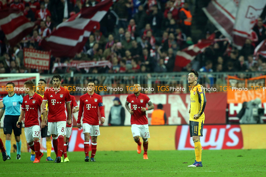 Arsenal's Mesut Ozil looks on in disbelief as Bayern Munich celebrate their fifth goal during FC Bayern Munich vs Arsenal, UEFA Champions League Football at the Allianz Arena on 15th February 2017