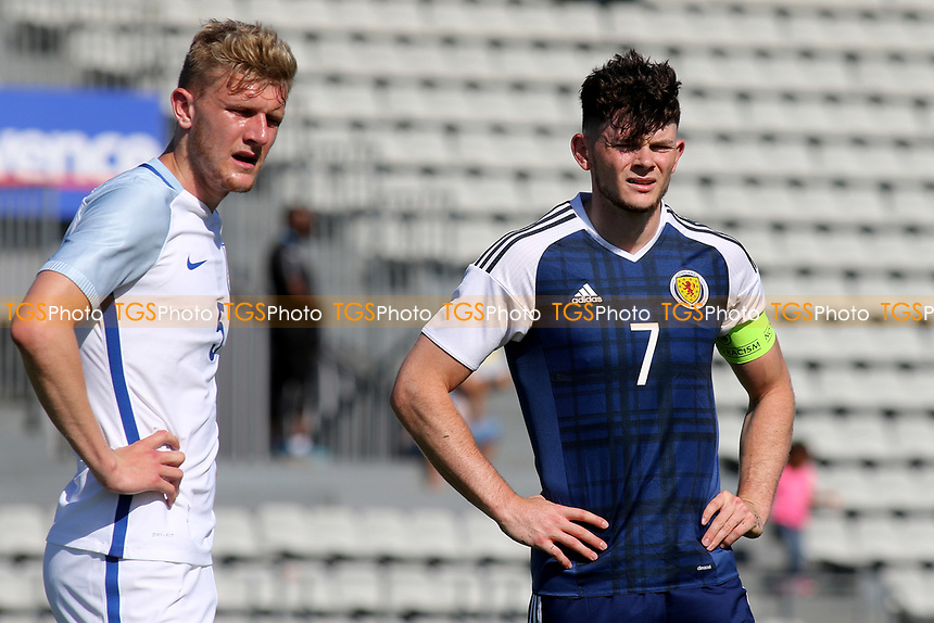 Joe Worrall of England and Scotland's Oliver Burke during England Under-18 vs Scotland Under-20, Toulon Tournament Semi-Final Football at Stade Parsemain on 8th June 2017
