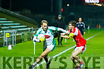 Eoin Walsh, Na Gaeil, gets away from the clutches of St Pats Jordan Conway when the sides met in the St Bendans board final at Austin Stack Park Tralee last Friday night.