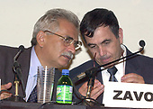 """Dr. Severino Antinori,  Director,  International Associated Research Institute,  left, and Dr. Panayiotis Michael Zavos, Director and Chief Andrologist, The Andrology Institute, right, appear on a panel on the """"Scientific and Medical Aspects of Human Cloning"""" in Washington, DC on August 7, 2001.<br /> Credit: Ron Sachs / CNP"""